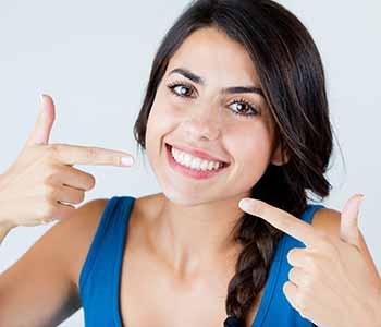 Dr. Hanif Asaria of Calgary Dental Centers in Calgary, AB for convenient, customized teeth whitening trays and tips to maintain your professionally brightened smile.
