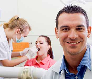 Emergency Dental Service Calgary - Dentist examine her patient's teeth