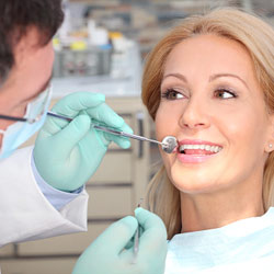 Dental Hygiene Therapy Calgary - Dentists with a Patient